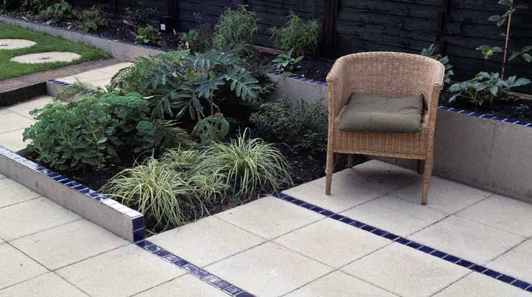 Parallel lines of glazed tiles draw the eye down the garden
