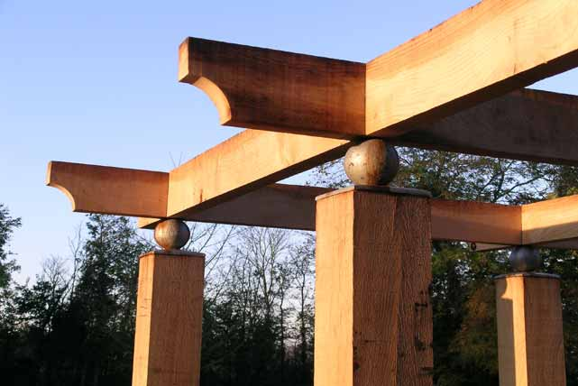 The pergola: oak joists sit on steel ball post caps