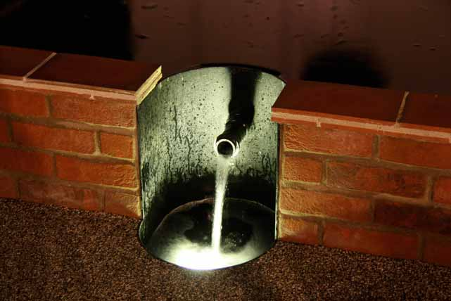 One of the water spouts lit up by an underwater spot